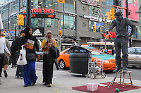 The little tramp and curious passers by at Yonge Dundas, Toronto, Canada