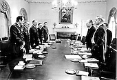United States President Gerald R. Ford meets with United States Secretary of Defense James R. Schlesinger and the Joint Chiefs of Staff in the Cabinet Room of the White House in Washington, D.C. on August 13, 1974.  From left to right: General David C. Jones, United States Air Force; General Creighton W. Abrams, United States Army; General George S. Brown, United States Air Force, Chairman of the Joint Chiefs of Staff; Admiral James L. Holloway, III, United States Navy; General Robert E. Cushman, Jr., United States Marine Corps; President Ford; and Secretary Schlesinger (with pipe).  <br /> Mandatory Credit: David Hume Kennerly / White House via CNP