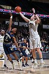 Alex Sharp (14) of the Wake Forest Demon Deacons fights for a rebound against Imani Tilford (0) of the Georgia Tech Yellow Jackets during first half action at the LJVM Coliseum on January 22, 2017 in Winston-Salem, North Carolina.  The Demon Deacons defeated the Yellow Jackets 70-65 in overtime.  (Brian Westerholt/Sports On Film)