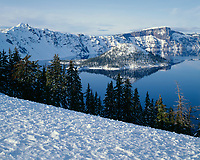 ORCL 009 - USA, Oregon, Crater Lake National Park, Winter snow on west rim of Crater Lake and Wizard Island.