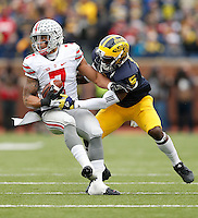 Ohio State Buckeyes wide receiver Jalin Marshall (7) spins around Michigan Wolverines safety Jabrill Peppers (5) during the NCAA football game at Michigan Stadium in Ann Arbor on Nov. 28, 2015. Ohio State won 42-13. (Adam Cairns / The Columbus Dispatch)