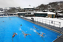 24/03/13 ..Surrounded by snow, swimmers brave sub zero temperatures this morning on the opening weekend of the Hathersage outdoor swimming pool in the Derbyshire Peak District...All Rights Reserved - F Stop Press.  www.fstoppress.com. Tel: +44 (0)1335 300098.