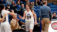 Photo courtesy of John Brown University<br /> John Brown senior Baily Cameron is congratulated by teammates after coming out of Saturday's game against Mid-America Christian. Cameron became the JBU women's basketball program's all-time leading scorer on Saturday.