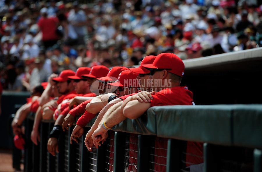Mar. 4, 2012; Phoenix, AZ, USA; Los Angeles Angels players in the dugout against the Oakland Athletics during a spring training game at Phoenix Municipal Stadium.  Mandatory Credit: Mark J. Rebilas-