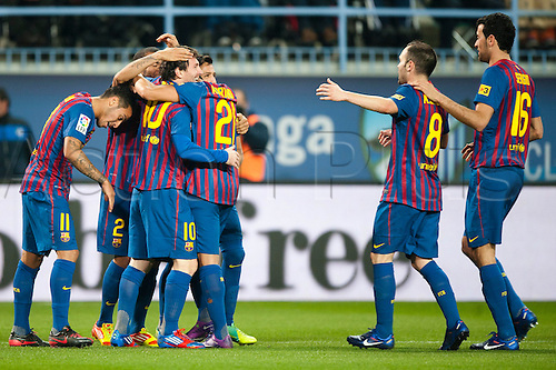 22.01.2012 Malaga, Spain. The La Liga football match between FC Malaga and FC Barcelona played in the La Rosaleda Stadium. Image shows, Lionel Messi from Argentina (FC Barcelona) reacts  with teammates after scoring 0:3 against Malaga CF during a Spanish La Liga soccer match..
