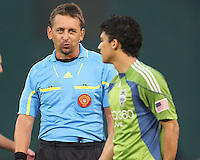 Fredy Montero #17 of Seattle Sounders FC is warned by referee Alex Prus during an MLS match against D.C. United at RFK Stadium on July 15 2010, in Washington DC.Seattle won 1-0.