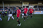 Bala Town 3 FC Differdange 4, 03/08/2015. Belle Vue, Europa League. Players walking on to the pitch before the Europa League first qualifying round, second leg tie between Bala Town from Wales and FC Differdange 03 of Luxembourg. It was the Welsh club's second season of European competition, and due to ground regulations the match was played at nearby Belle Vue, home of Rhyl FC. The visitors won the tie 4-3 on aggregate due to a last-minute away goal by Omar Er Rafik, in a game watched by 1039 fans and progressed to play Turkish giants Trabzonspor in the next round. Photo by Colin McPherson.