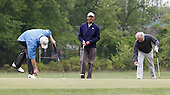 United States President Barack Obama plays golf with U.S. Senators Bob Corker, (Republican of Tennessee), right, Saxby Chambliss (Republican of Georgia), left, and Mark Udall (Democrat of Colorado), not shown, at Joint Base Andrews on May 6, 2013. .Credit: Dennis Brack / Pool via CNP