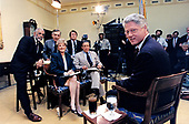 United States President Bill Clinton poses for a photo as he records an interview with the CBS program &quot;60 Minutes&quot; in the Roosevelt Room of the White House in Washington, DC on December 8, 1995.  Pictured are Ed Bradley, Morley Safer, Lesley Stahl, Steve Kroft, Mike Wallace, and President Clinton.<br /> Mandatory Credit: Robert McNeely / White House via CNP