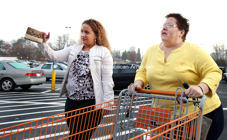 SOUTINGTON CT. 26 November 2015-112715SV05-Elizabeth Santiago and her daughter Alexa Santiago both of Waterbury continue their shopping trip at Home Depot in Southington Friday. The two started shopping at 3pm Thursday, took a 2-hour nap and continued with their Black Friday shopping. <br /> Steven Valenti Republican-American