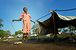 A girl jumps rope in the Gendrassa refugee camp in South Sudan's Upper Nile State. More than 110,000 refugees were living in four camps in Maban County in October 2012, but officials expected more would arrive once the rainy season ended and people could cross rivers that block the routes from Sudan's Blue Nile area, where Sudanese military has been bombing civilian populations as part of its response to a local insurgency. Conditions in the camps are often grim, with outbreaks of diseases such as Hepatitis E.