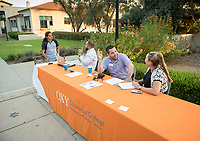 Staffers Andy Mezquita, Jason Barquero, Michael Witt and Stephany Bustos. Career Services hosts the Summer Experience Expo, where Occidental College student interns from the InternLA program and INT Internship course shared information about the organizations they worked for over the summer. Sept. 7, 2017 at Thorne Hall patio. Employers were also in attendance.<br /> (Photo by Marc Campos, Occidental College Photographer)