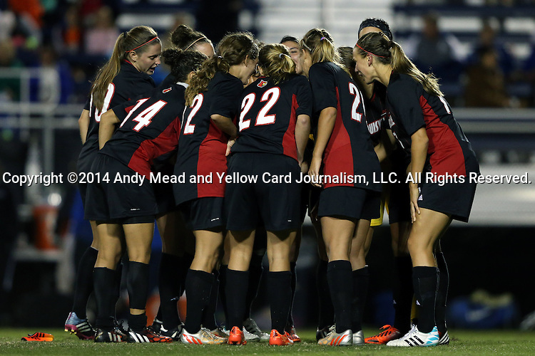 04 October 2014: Louisville players huddle before the second half. The Duke University Blue Devils hosted the University of Louisville Cardinals at Koskinen Stadium in Durham, North Carolina in a 2014 NCAA Division I Women's Soccer match. The game ended in a 0-0 tie after double overtime.