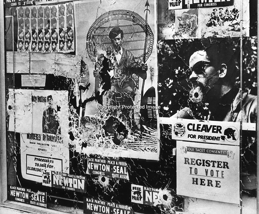 Bullet riddled posters in the window of Black Panther headquarters in Oakland, Ca (copyright 1967 photo by Ron Riesterer)