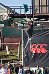 A Waiuku supporter perches atop the Canterbury billboard during  Counties Manukau Premier Club Rugby final between Patumahoe & Waiuku played at Bayers Growers Stadium Pukekohe on Saturday August 8th 2009. Patumahoe won 11 - 9 after leading 11 - 6 at halftime.