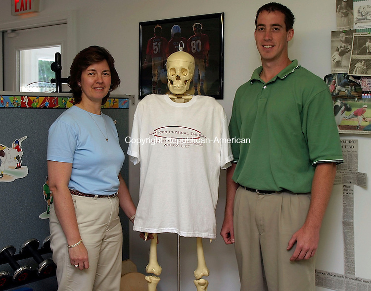 WOLCOTT, CT- 12 JUNE 2005- 061205DA02.JPG - Advanced Physical Therapy Inc. L-R (Office Manager) Kathy Finke, Jack the skeleton and (owner) David Donnelly. For Marketplace. Staff Photo. Darlene Douty