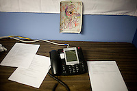 A page from a My Little Pony children's coloring book hangs above a phone at the Rick Santorum New Hampshire campaign headquarters in Bedford, New Hampshire, on Jan. 7, 2012.  Santorum is seeking the 2012 Republican presidential nomination.