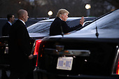 United States President Donald Trump waves as he leave the Blair House after paying a visit to the family of former President George H.W. Bush December 04, 2018 in Washington, DC. The Trumps were paying a condolence visit to the Bush family who are in Washington for former President George H.W. Bushs state funeral and related honors. <br /> Credit: Chip Somodevilla / Pool via CNP