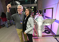 NWA Democrat-Gazette/J.T. WAMPLER Jerry and Julie Moody of Fayetteville pose Sunday Dec. 31, 2017 with the lighted hog used in the Last Night Fayetteville Hog Drop Countdown to Midnight on the Fayetteville Square. Last Night is a performing arts festival featuring more than 100 local artists on 11 stages.