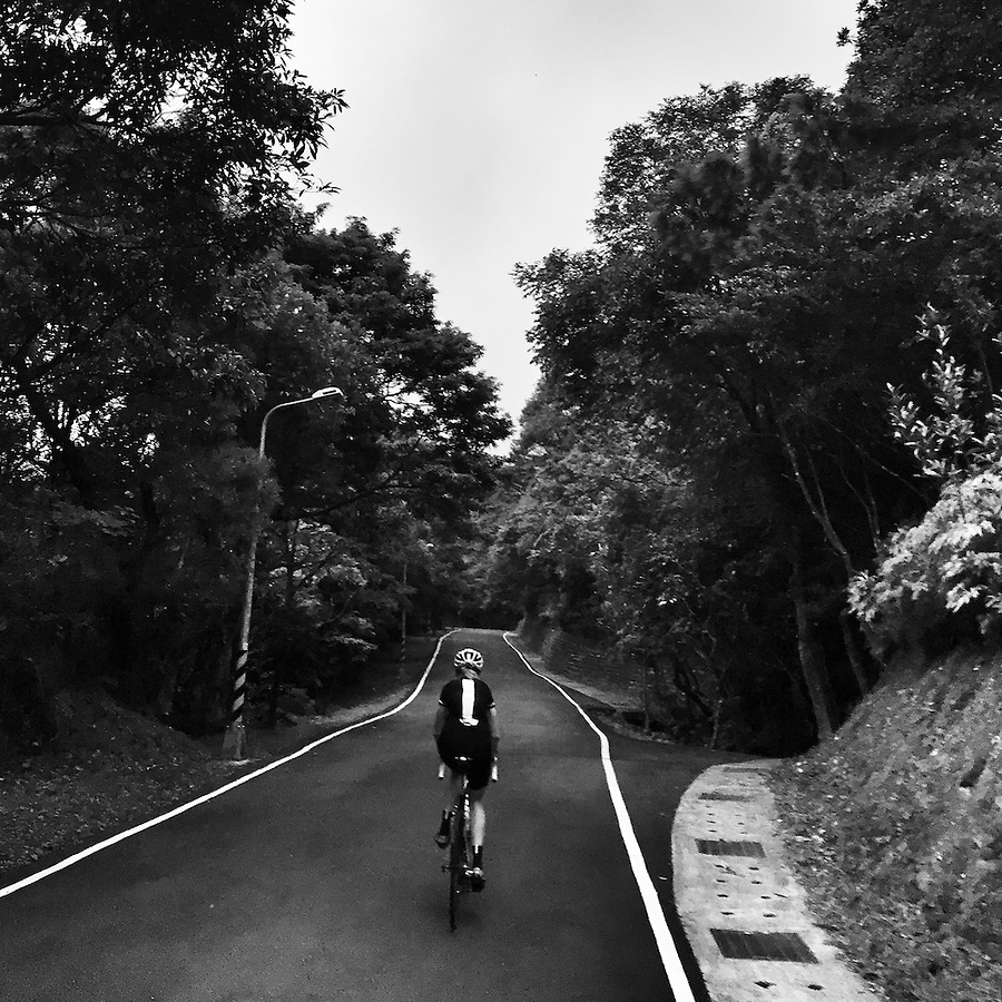 Cycling through the narrow lanes of Yangmingshan National Park, near Taipei, Taiwan.