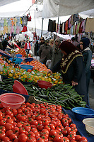 Woman looking at fruit for sale in a colourful market in Istanbul, Turkey