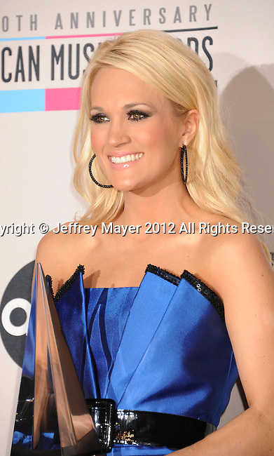LOS ANGELES, CA - NOVEMBER 18: Carrie Underwood  poses in the press room at the 40th Anniversary American Music Awards held at Nokia Theatre L.A. Live on November 18, 2012 in Los Angeles, California.