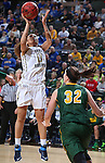 SIOUX FALLS, SD - MARCH 8: Atoe' Jackson #0 of Oral Roberts shoots over Marena Whittle #32 of NDSU in the first half of their first round Summit League Championship Tournament game Sunday afternoon at the Denny Sanford Premier Center in Sioux Falls, SD. (Photo by Dick Carlson/Inertia)