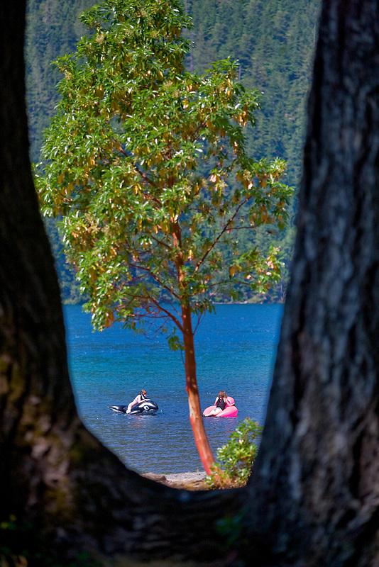 Girls palying in Lake Crescent. Olympic National Park. Washington