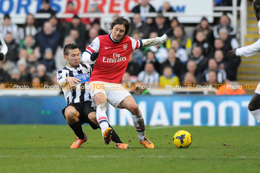 Tomáš Rosický of Arsenal battles with Yohan Cabaye of Newcastle United - Newcastle United vs Arsenal - Barclays Premier League Football at St James Park, Newcastle upon Tyne - 29/12/13 - MANDATORY CREDIT: Steven White/TGSPHOTO - Self billing applies where appropriate - 0845 094 6026 - contact@tgsphoto.co.uk - NO UNPAID USE