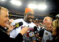 Jan 10, 2011; Glendale, AZ, USA; Auburn Tigers defensive tackle Nick Fairley (90) is interviewed by the media following the game against the Oregon Ducks in the 2011 BCS National Championship game at University of Phoenix Stadium. Auburn defeated Oregon 22-19. Mandatory Credit: Mark J. Rebilas-