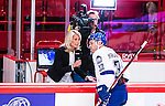 Stockholm 2014-09-17 Ishockey SHL Djurg&aring;rdens IF - Leksands IF :  <br /> Cmores Lovisa Giertta intervjuar Leksands Fredrik Forsberg under en periodpaus i matchen mellan Djurg&aring;rden och Leksand<br /> (Foto: Kenta J&ouml;nsson) Nyckelord:  Djurg&aring;rden DIF Hockey Globen Ericsson Globe Arena SHL Leksand LIF TV intervju Cmore