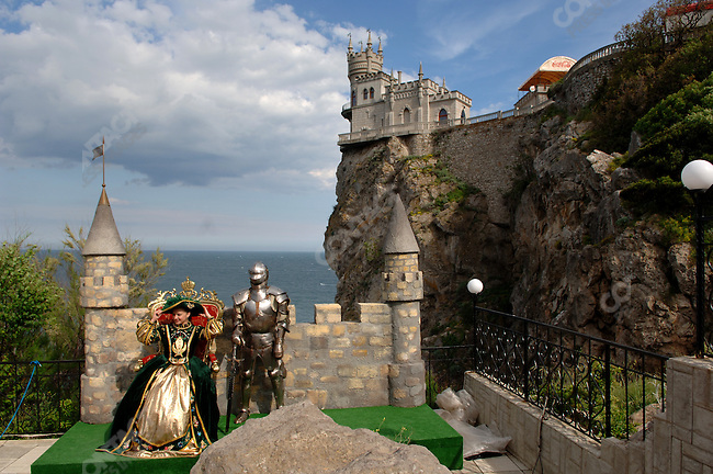 A woman poses for a photograph in costume at Swallow's Nest palace, located just outside of Yalta. Republic of Crimea, May 27, 2006.