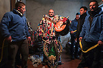 Raul Beites 34, waits to be dressed as Jarramplas and make his way through the streets beating his drum during the Jarramplas Festival on January 20, 2015 in Piornal, Spain. The centuries old Jarramplas festival takes place annually every January 19-20 on Saint Sebastian Day. Even though the exact origins of the festival are not known, various theories exist including the mythological punishment of Caco by Hercules, a relation to ceremonies celebrated by the American Indians that were seen by the first conquerors, to a cattle thief ridiculed and expelled by his village neighbours. It is generally believed to symbolize the expulsion of everything bad. This year the people who represented Jarramplas were Angel Cerro Fernandez on 19 January and Carlos Calle Rodríguez 47 and Raúl Beites Sánchez 34 on 20 January. (c) Pedro ARMESTRE