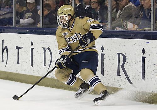 December 01, 2012:  Notre Dame defenseman Robbie Russo (#5) skates with the puck during NCAA Hockey game action between the Notre Dame Fighting Irish and the Lake Superior State Lakers at Compton Family Ice Arena in South Bend, Indiana.  Notre Dame defeated Lake Superior State 6-1.