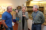 Kate McMahon, Director Of Development for Lunch Break, gives a tour of the facility to Jersey Central Power & Light Employees William Puchik (L) and John Mahon (R) prior to the presention of a check for $5,935.00 from JCP&L to Lunch Break in Red Bank, NJ on April 13, 2017.