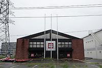 Landscape view of a damaged Uniqlo building at Sendai port following the 311 Tohoku Tsunami in Sendai, Japan  © LAN