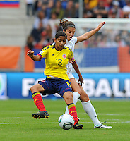 Carli Lloyd (r) of team USA and Yulieht Dominguez of team Colombia during the FIFA Women's World Cup at the FIFA Stadium in Sinsheim, Germany on July 2nd, 2011.