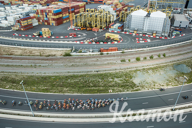 """Peloton riding through the Port of Antwerp.<br /> <br /> Antwerp Port Epic 2018 (formerly """"Schaal Sels"""")<br /> One Day Race: Antwerp > Antwerp (207km of which 32km are cobbles & 30km is gravel/off-road!)"""
