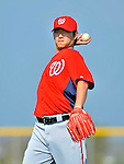 24 February 2012: Washington Nationals' pitcher Chien-Ming Wang warms up at the Carl Barger Baseball Complex in Viera, Florida. Mandatory Credit: Ed Wolfstein Photo
