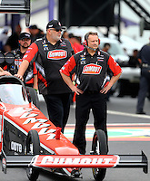Apr 24, 2015; Baytown, TX, USA; Crew chief Doug Cook (right) with NHRA top fuel driver Leah Pritchett during qualifying for the Spring Nationals at Royal Purple Raceway. Mandatory Credit: Mark J. Rebilas-