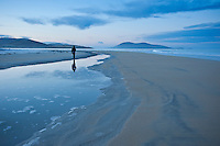 Reflection of person walking on Luskentyre beach, Isle of Harris, Western Isles, Scotland