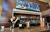 March 12, 2019. Encinitas, CA. USA| Bartender  Drew Matson tends the The Cinepolis Theater wet bar in the lobby. | Photos by Jamie Scott Lytle. Copyright.