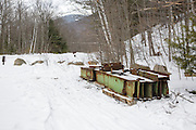 April 2013 - Debris near the Lincoln Woods Trailhead from the steel Black Brook footbridge. This bridge was located along the Wilderness Trail (Trestle 16 location of the EB&L RR) in the Pemigewasset Wilderness of New Hampshire. It was part of the 180 foot suspension bridge removal 1/2 -/+ mile east of this location along the Wilderness Trail. Per the Wilderness Act, only non-motorized equipment can be used to remove this material.