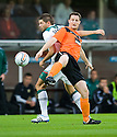 :: DUNDEE UTD'S JON DALY AND AMIR SPAHIC CHALLENGE FOR THE BALL ::