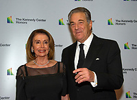 United States House Minority Leader Nancy Pelosi (Democrat of California) and her husband, Paul arrives for the formal Artist's Dinner honoring the recipients of the 41st Annual Kennedy Center Honors hosted by United States Deputy Secretary of State John J. Sullivan at the US Department of State in Washington, D.C. on Saturday, December 1, 2018.   <br /> CAP/MPI/RS<br /> &copy;RS/MPI/Capital Pictures