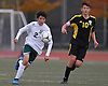 Carlos Salgado #2 of Carle Place, left, chases after a loose ball during the NYSPHSAA varsity boys soccer Class B Southeast Regional against Hastings at Mitchel Athletic Complex on Saturday, Nov. 5, 2016. Hastings defeated Carle Place by a score of 4-0.