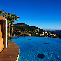 A curved infinity pool has stunning views of the Cote d'Azur, the Mediterranean and the red cliffs of the Esterel