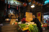 Taiwanese vendor sells vegetables in front of Shuixian Gong, or the Water Gods Temple, which was built in Qing Dynasty in Tainan, Taiwan, 2015.