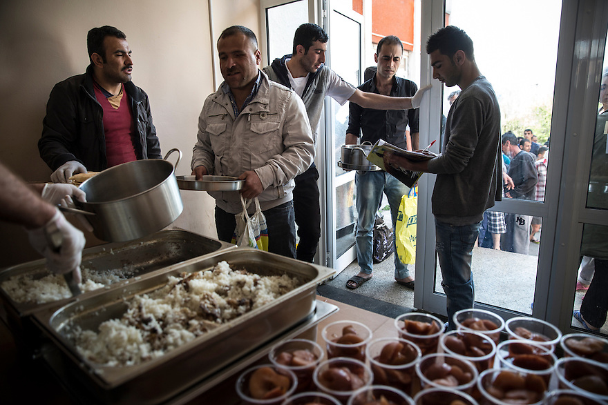 SOFIA, BULGARIA- Lunch is served at Voenna Rampa camp, where hundreds of asylum seekers wait for months to have their asylum claims to be approved.