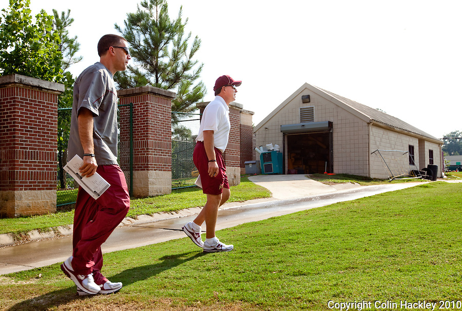 TALLAHASSEE, FL 8/5/10 FSU 080510 CH-Florida State Head Coach Jimbo Fisher, right, and Offensive Coordinator James Coley enter the field during the first day of practice Thursday in Tallahassee. .COLIN HACKLEY PHOTO